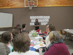 Sarah speaking to a group of women that get together each month to pray for missionaries.
